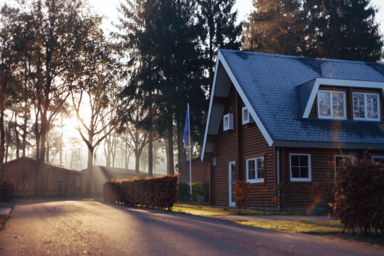 House with steep roof and sunset