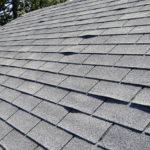 Curling shingles on a roof
